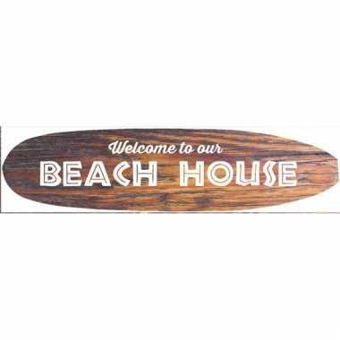 Metalen surfboard beach house